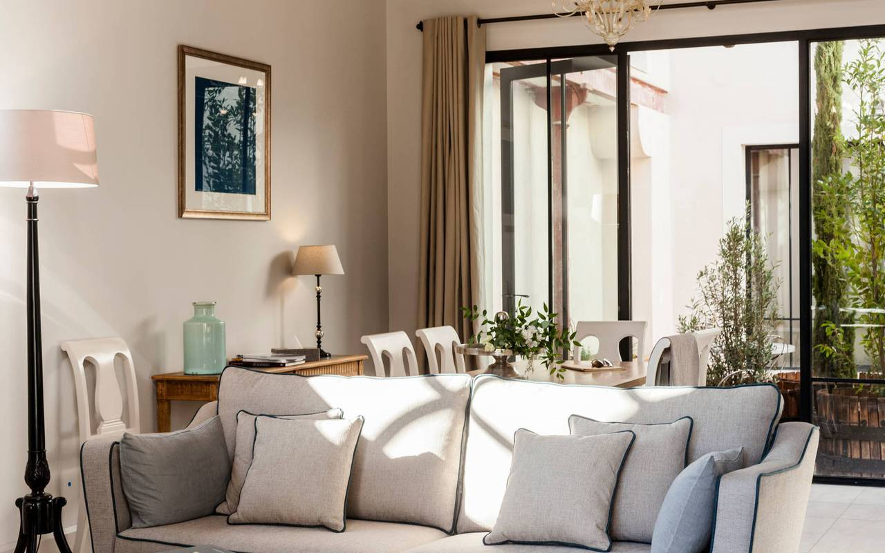 Elegant living room with bay window in one of our luxury self-catering villa in Languedoc, Château St Pierre de Serjac.