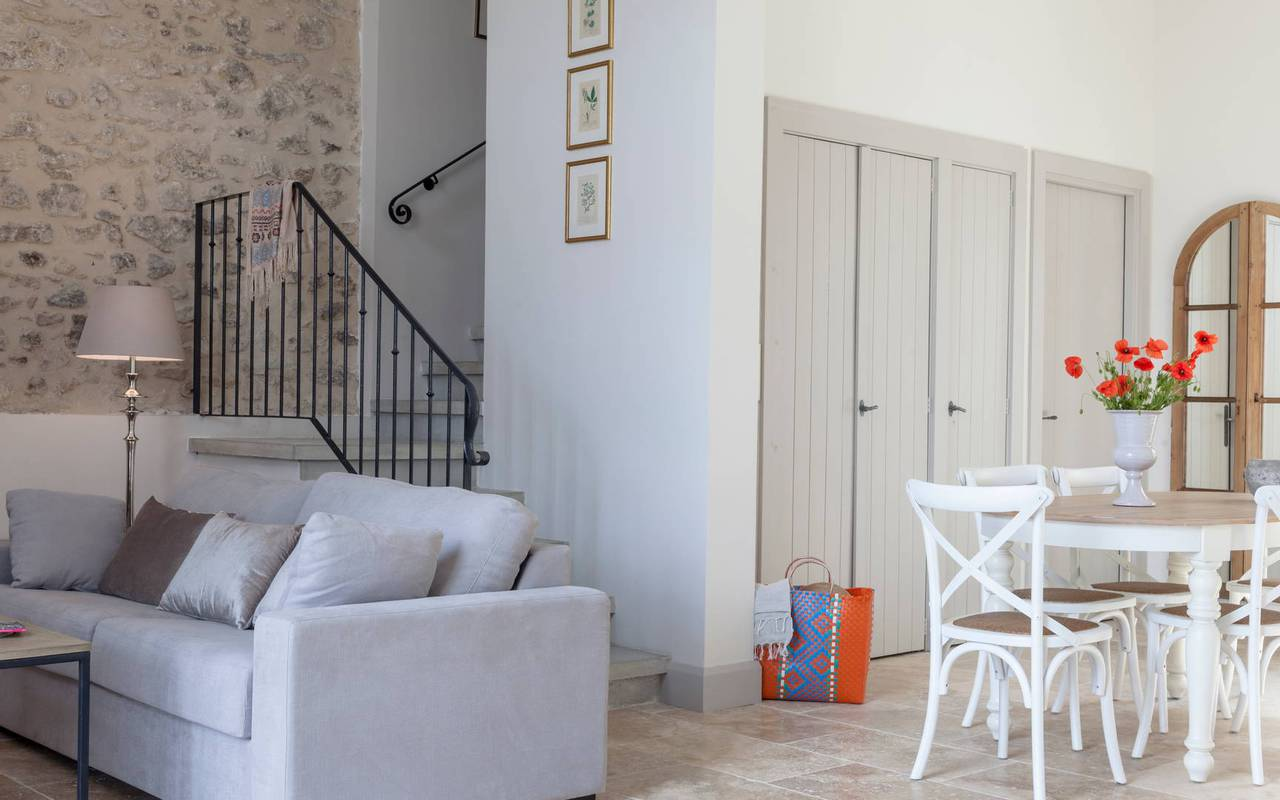 view of the living room with stone wall in one of our luxury self-catering villa in Languedoc, Château St Pierre de Serjac.