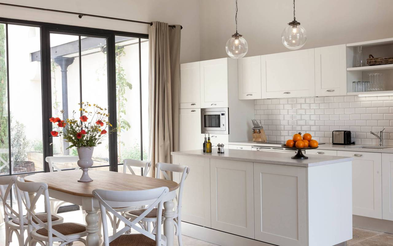 Modern open kitchen in one of our luxury self-catering in Languedoc, Château St Pierre de Serjac.