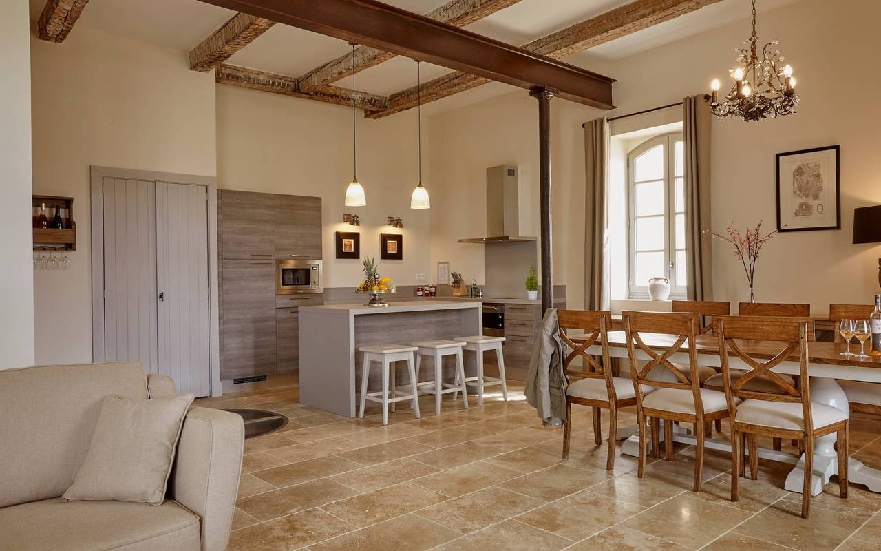 Spacious living room with open kitchen in one of our luxury self catering in Languedoc, Château St Pierre de Serjac.
