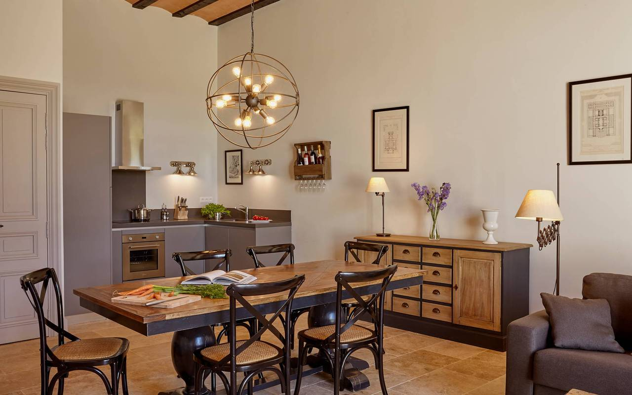 Modern living room with kitchen, in one of our luxury self catering in Languedoc, Château St Pierre de Serjac.