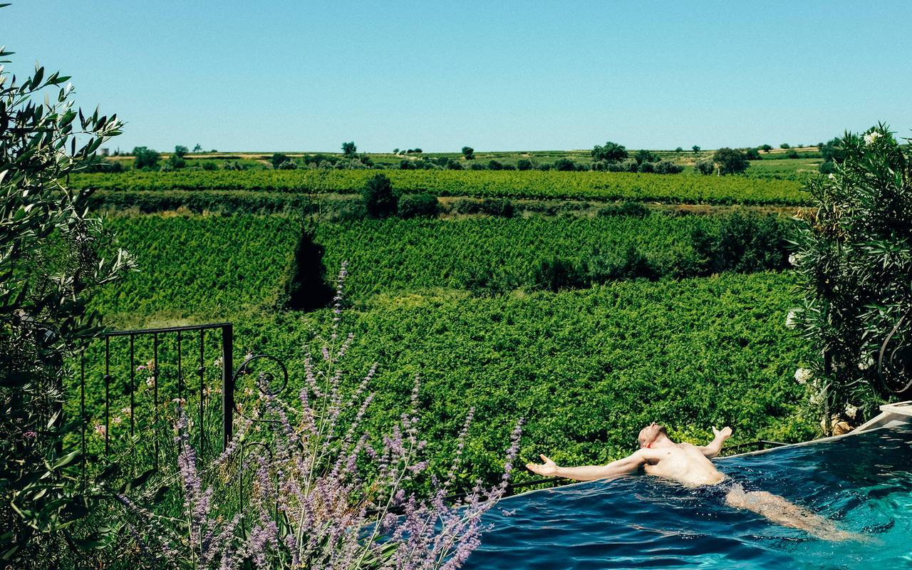 Private infinity pool overlooking the vineyards, in our  luxury self catering villa in Languedoc, Château St Pierre de Serjac.