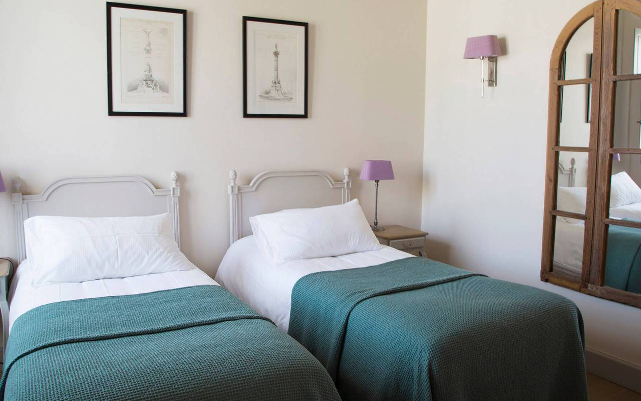 View of the bedroom with twin beds of La Maison des Vignerons,  in our  luxury self catering in Languedoc, Château St Pierre de Serjac.