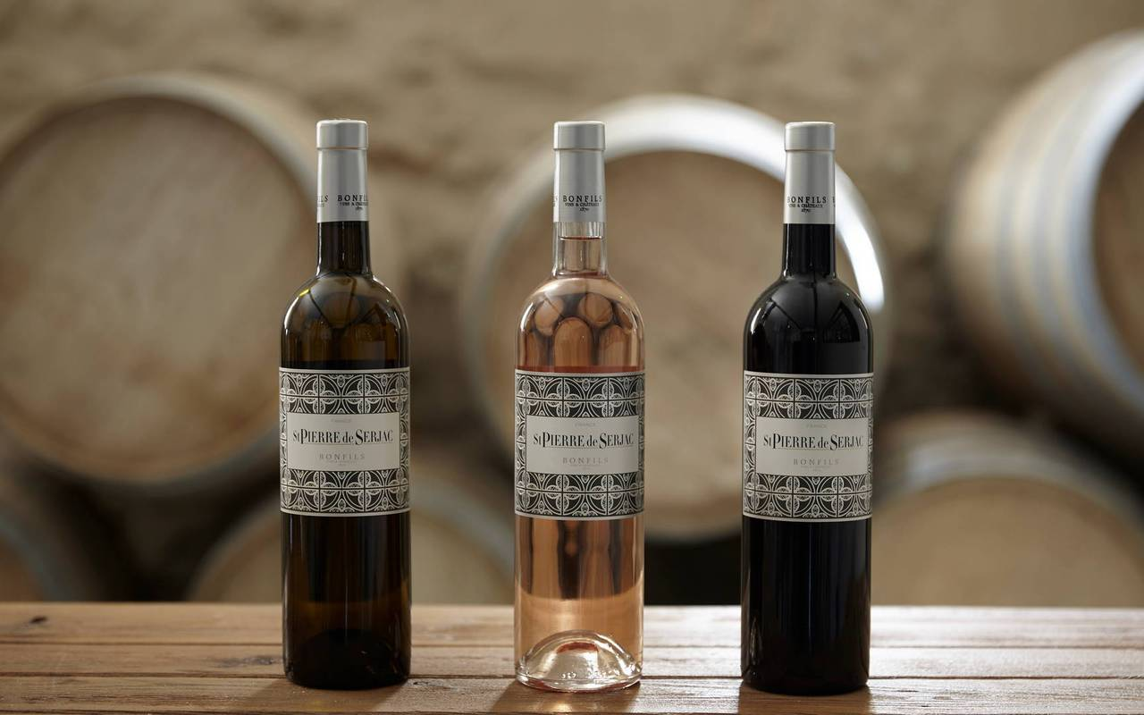 Bottles of wine of our wine estate Château St Pierre de Serjac, wine tours in Languedoc.