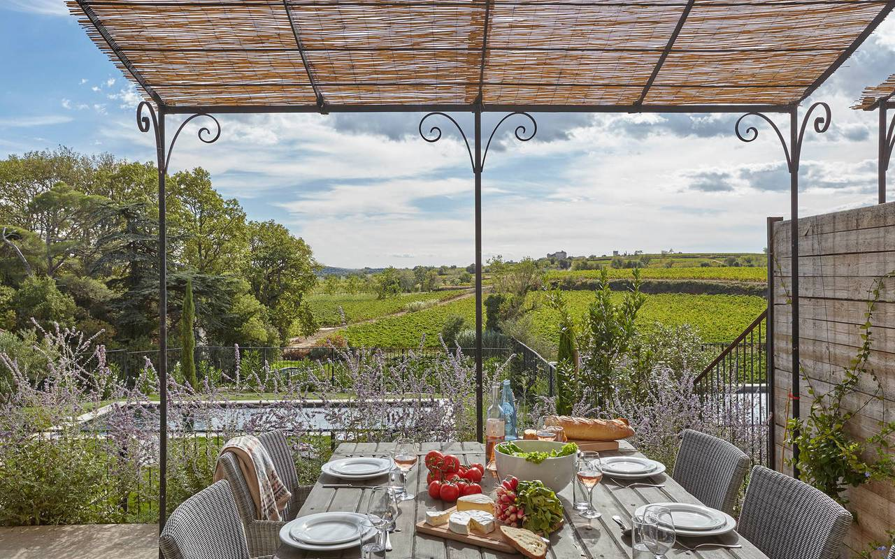 Large terrace with table in one of our luxury self catering in Languedoc, Château St Pierre de Serjac.