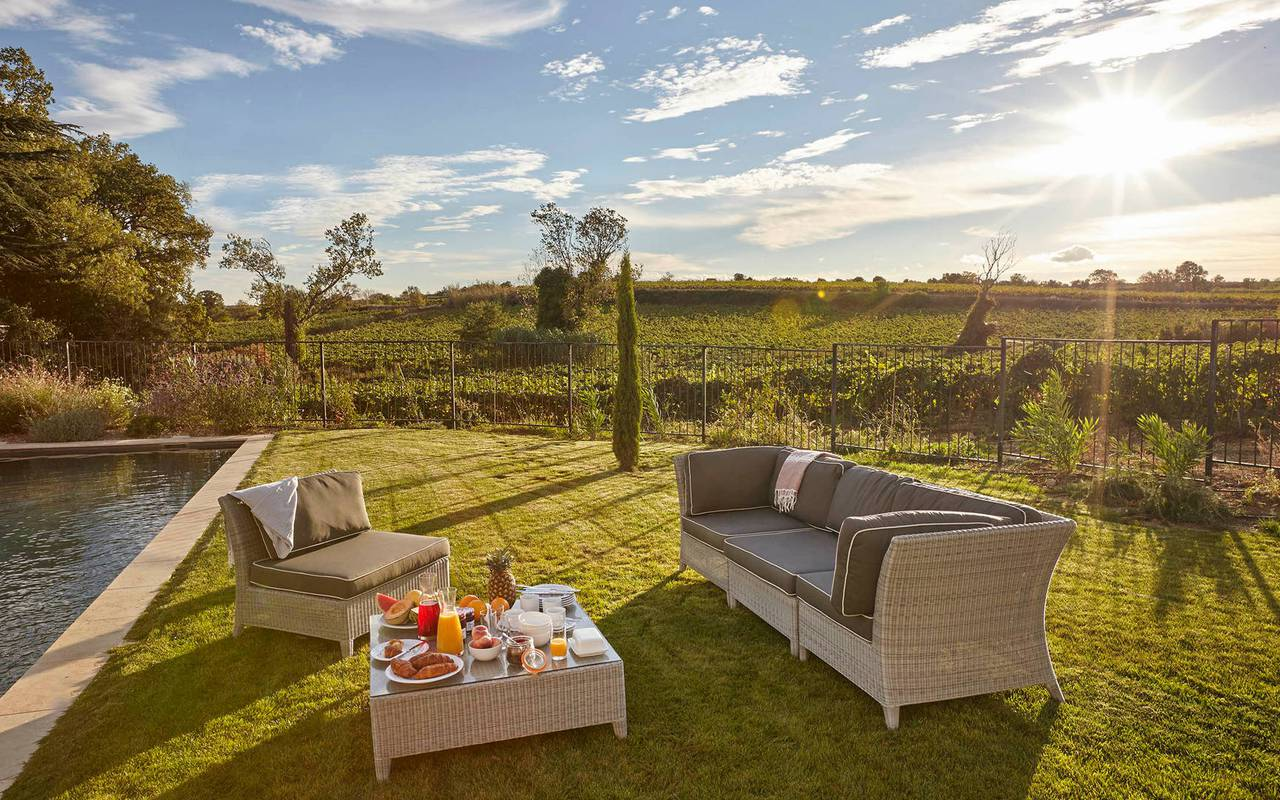 Private garden with pool and garden furniture, in one of our luxury self catering in Languedoc, Château St Pierre de Serjac.