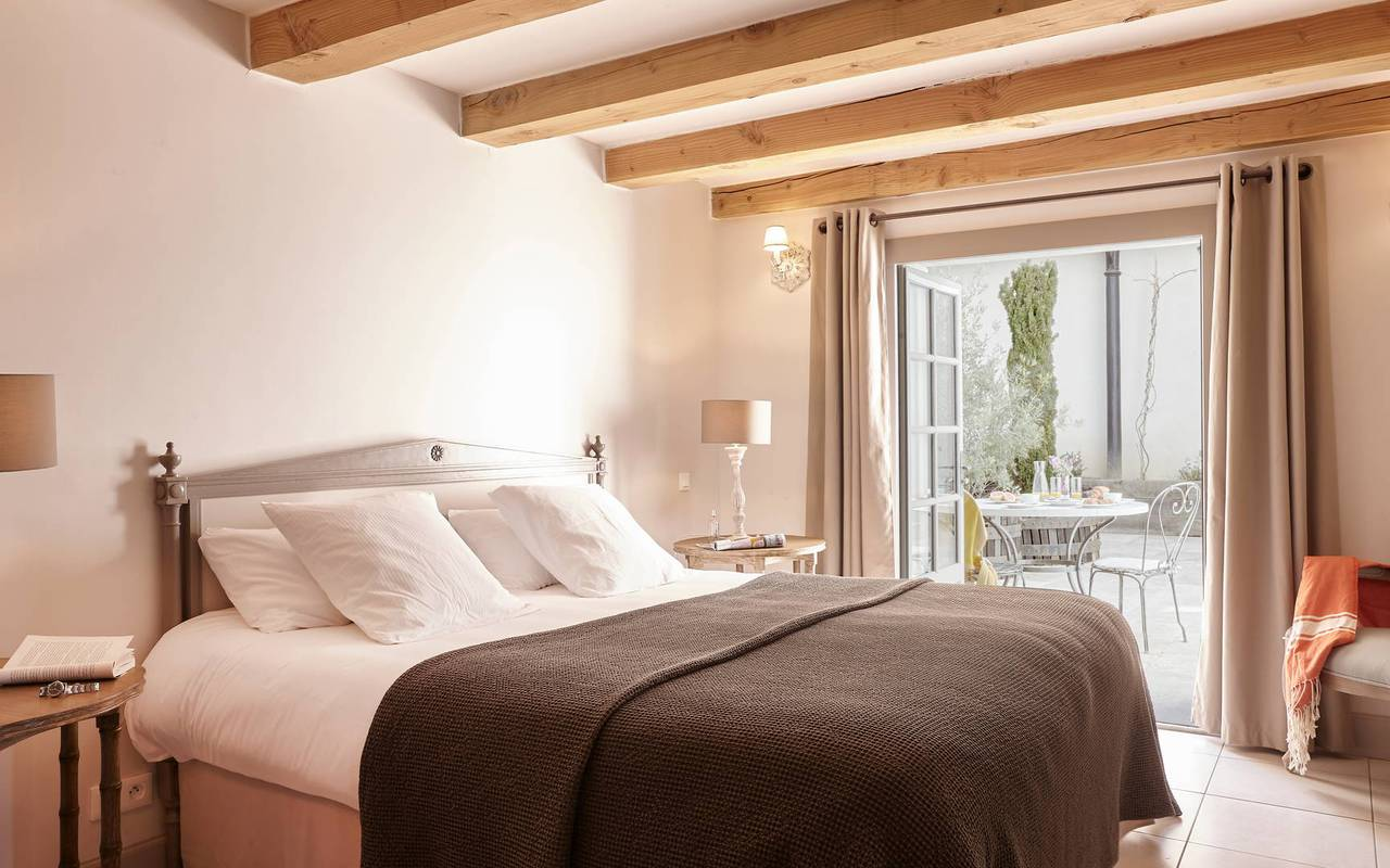 Elegant bedroom open into the terrace in one of our luxury self catering in Languedoc, Château St Pierre de Serjac.