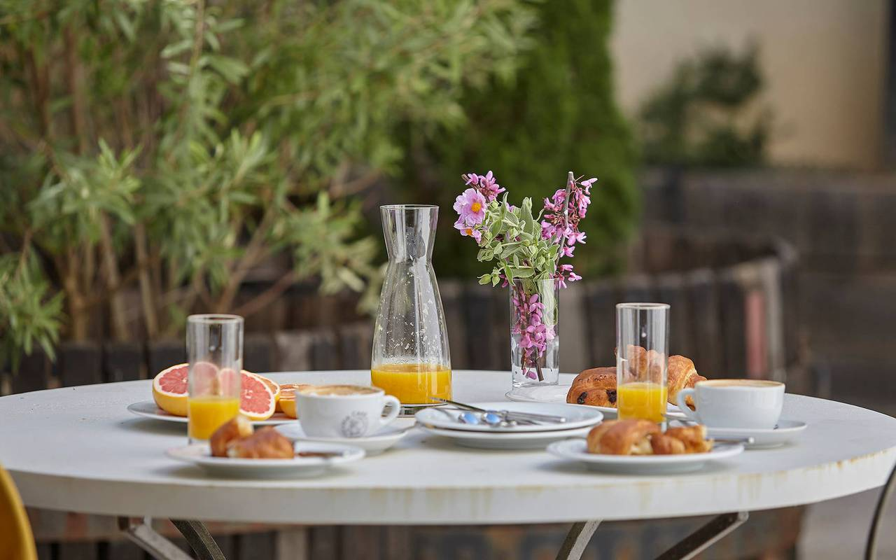 Table in the terrace with breakfast  in one of our luxury self catering in Languedoc, Château St Pierre de Serjac.