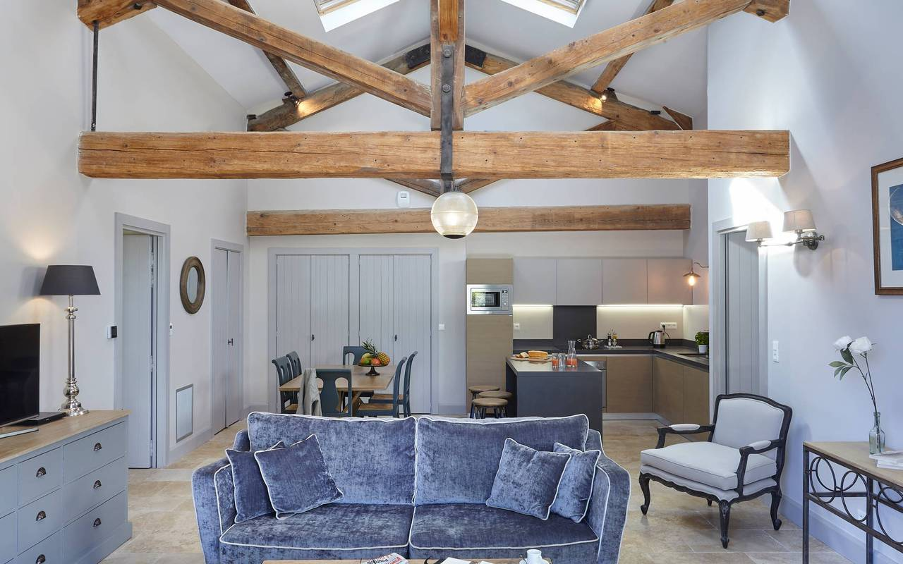 Spacious living room with exposed beams in one of our luxury self catering in Languedoc, Château St Pierre de Serjac.