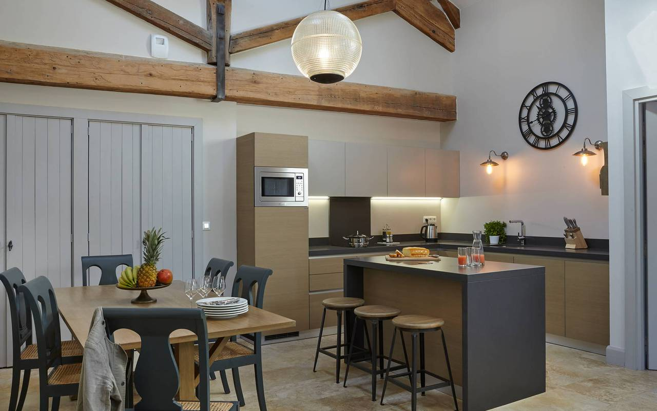 View of the kitchen and dining area in one of our luxury self catering in Languedoc, Château St Pierre de Serjac.
