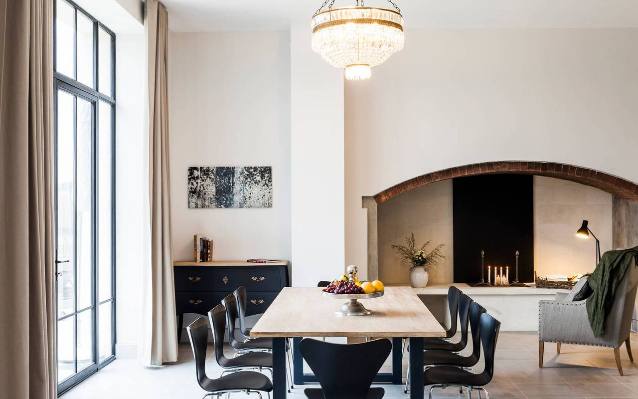 Dining area with fire place in one of our luxury self catering in Languedoc, Château St Pierre de Serjac.