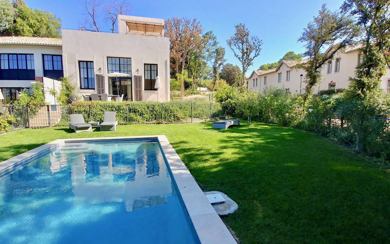 Garden with pool of our Languedoc holiday home, in Château St Pierre de Serjac.