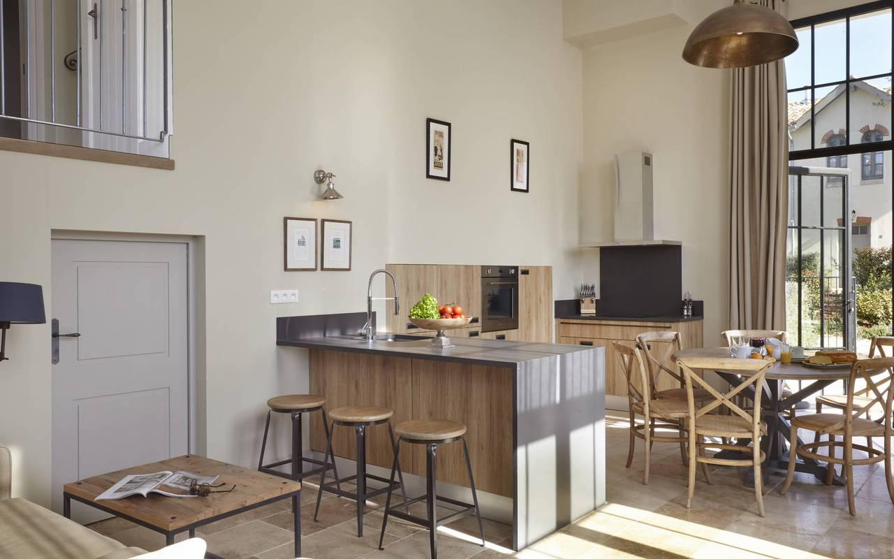 Kitchen and living room of our Languedoc holiday home, in Château St Pierre de Serjac.