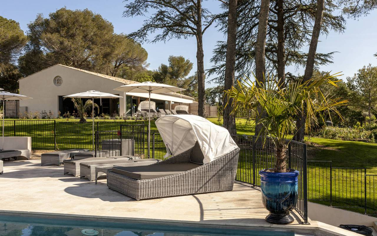 Sunbeds by the pool, Languedoc holiday home, in Château St Pierre de Serjac.