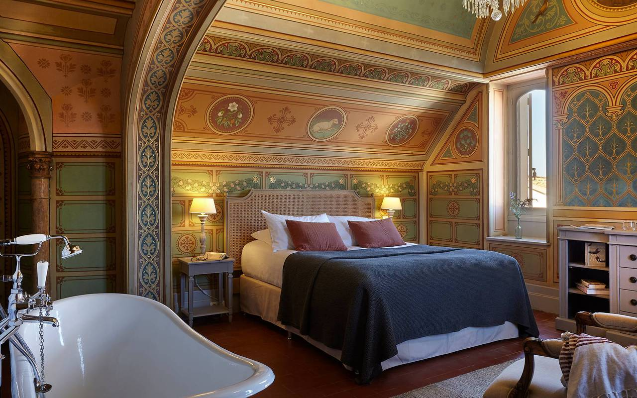 Room La Chapelle with authentic decoration in our Landegoc holiday rentals, the Château St Pierre de Serjac.