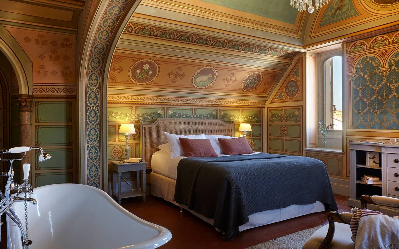 view of the room La Chapelle with original hand painted wallpapers,  in our hotel in Languedoc, Château de Serjac.