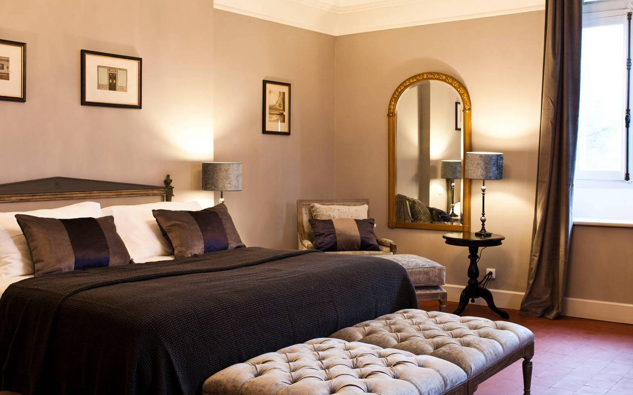 Elegant room with large bed, in our hotel in Languedoc, Château St Pierre de Serjac.